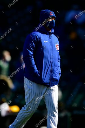 Chicago Cubs manager David Ross walks to the dugout after visiting the mound during the fourth inning of the team's baseball game against the Pittsburgh Pirates, on opening day at Wrigley Field in Chicago. Pittsburgh won 5-3
