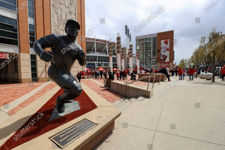 Stock Picture of View of the statue of former Reds' player Joe Morgan as fans wait to enter the ballpark prior to the baseball game between the St. Louis Cardinals and the Cincinnati Reds in Cincinnati