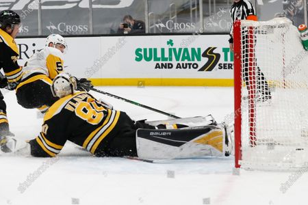 Pittsburgh Penguins' Mike Matheson tucks the puck past Boston Bruins goaltender Dan Vladar for a goal during the second period of an NHL hockey game, in Boston