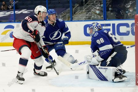Columbus Blue Jackets left wing Eric Robinson (50) watches his shot get past Tampa Bay Lightning goaltender Andrei Vasilevskiy (88) for a goal during the third period of an NHL hockey game, in Tampa, Fla