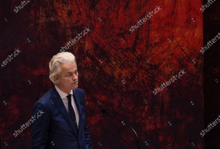 Populist Dutch anti-immigration lawmaker Geert Wilders reacts during a debate in parliament in The Hague, Netherlands, early . Caretaker Dutch Prime Minister Mark Rutte was fighting for his political life in a bitter parliamentary debate about the country's derailed process of forming a new ruling coalition following elections last month