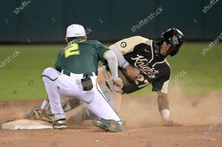 Central Florida's Gephry Pena (27) steals second base under the tag of South Florida infielder Nick Gonzalez during an NCAA college baseball game, in Tampa, Fla