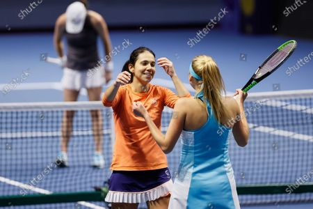 Nadiia Kichenok (R) of Ukraine and Raluca Olaru (C) of Romania celebrate victory during their WTA St. Petersburg Ladies Trophy 2021 tennis tournament women doubles final match against United States couple Kaitlyn Christian and Sabrina Santamaria on March 21, 2021 at Sibur Arena in Saint Petersburg, Russia.