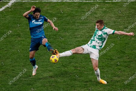 Sardar Azmoun (L) of Zenit Saint Petersburg and Andrey Semenov of Akhmat vie for the ball during the Russian Premier League match between FC Zenit Saint Petersburg and FC Akhmat Grozny on March 13, 2021 at Gazprom Arena in Saint Petersburg, Russia.