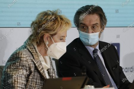 Stock Image of Vice Governor and Health and Welfare Minister of Lombardy Letizia Moratti and Lombardy region president Attilio Fontana attend a news conference at Lombardy region headquarter, in Milan, Italy