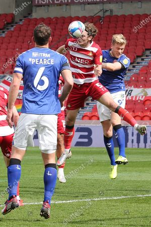 Doncaster Rovers defender Joe Wright (5) heads the ball during the EFL Sky Bet League 1 match between Doncaster Rovers and Charlton Athletic at the Keepmoat Stadium, Doncaster