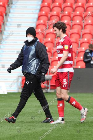 Doncaster Rovers defender Joe Wright (5) leaves the filed of play after receiving treatment during the EFL Sky Bet League 1 match between Doncaster Rovers and Charlton Athletic at the Keepmoat Stadium, Doncaster