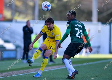 AFC Wimbledon defender Luke O'Neill (2) plays the ball forward around Plymouth Argyle Wing-back Adam Lewis (22)  during the EFL Sky Bet League 1 match between Plymouth Argyle and AFC Wimbledon at Home Park, Plymouth