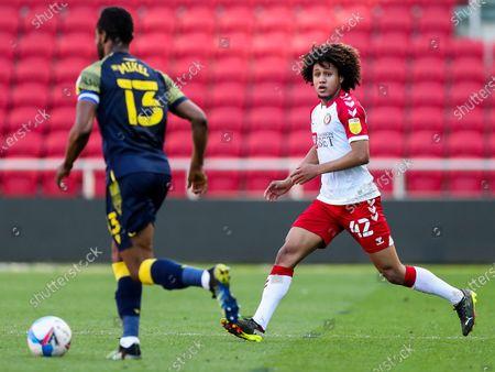 Mikel John Obi of Stoke City is challenged by Han-Noah Massengo of Bristol City