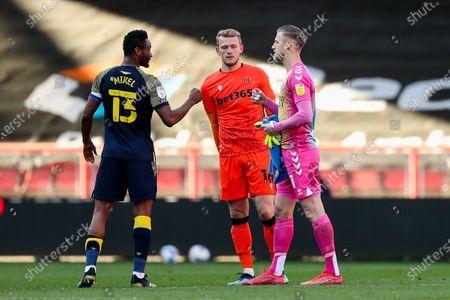 Mikel John Obi of Stoke City and Daniel Bentley of Bristol City after Stoke City win 0-2