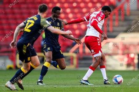 Tyreeq Bakinson of Bristol City is challenged by Mikel John Obi of Stoke City