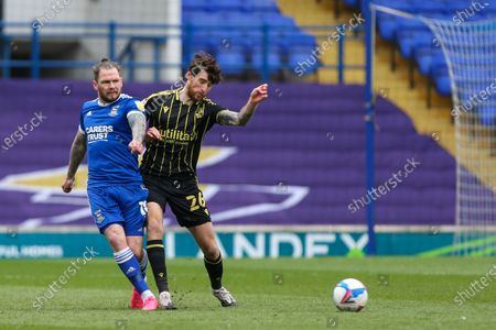 Jack Baldwin of Bristol Rovers closes down James Norwood of Ipswich Town