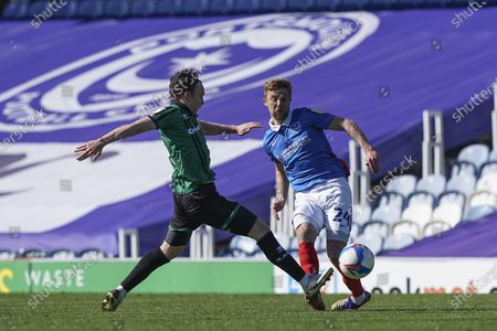 Michael Jacobs of Portsmouth passes under pressure during the EFL Sky Bet League 1 match between Portsmouth and Rochdale at Fratton Park, Portsmouth