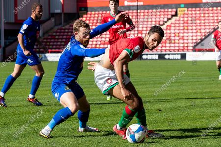 Stock Photo of Max Melbourne of Walsall  holds off George Thomson of Harrogate Town during the EFL Sky Bet League 2 match between Walsall and Harrogate Town at the Banks's Stadium, Walsall