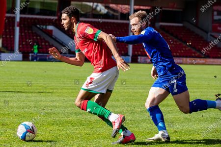 Emmanuel Osadebe of Walsall  on wing followed by George Thomson  of Harrogate Townduring the EFL Sky Bet League 2 match between Walsall and Harrogate Town at the Banks's Stadium, Walsall