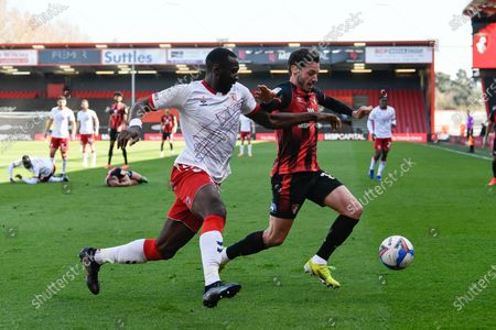 Adam Smith (15) of AFC Bournemouth battles for possession with Yannick Bolasie (14) of Middlesbrough during the EFL Sky Bet Championship match between Bournemouth and Middlesbrough at the Vitality Stadium, Bournemouth