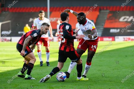 Yannick Bolasie (14) of Middlesbrough battles for possession with Adam Smith (15) of AFC Bournemouth and Jack Wilshere (11) of AFC Bournemouth during the EFL Sky Bet Championship match between Bournemouth and Middlesbrough at the Vitality Stadium, Bournemouth