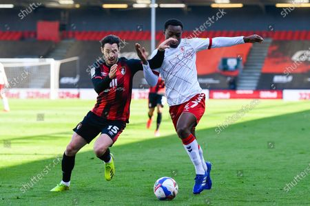 Adam Smith (15) of AFC Bournemouth battles for possession with Marc Bola (27) of Middlesbrough during the EFL Sky Bet Championship match between Bournemouth and Middlesbrough at the Vitality Stadium, Bournemouth