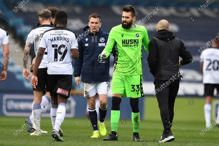 Millwall midfielder Jed Wallace(7)  goalscorer and Millwall goalkeeper Bartosz Bialkowski(33) penalty save hero at full time during the EFL Sky Bet Championship match between Millwall and Rotherham United at The Den, London