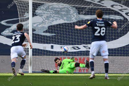 Millwall goalkeeper Bartosz Bialkowski(33)  makes a penalty save during the EFL Sky Bet Championship match between Millwall and Rotherham United at The Den, London