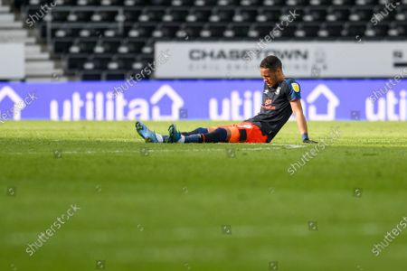 Stock Photo of Luton Town midfielder Thomas Ince (39) is injured during the EFL Sky Bet Championship match between Derby County and Luton Town at the Pride Park, Derby