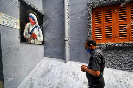 A Christian devotee offers prayers in front of the picture of Mother Teresa during Good Friday in Kolkata.Good Friday is a Christian holiday commemorating the crucifixion of Jesus and his death at Calvary. It is observed during Holy Week as part of the Paschal Triduum on the Friday preceding Easter Sunday, and may coincide with the Jewish observance of Passover.