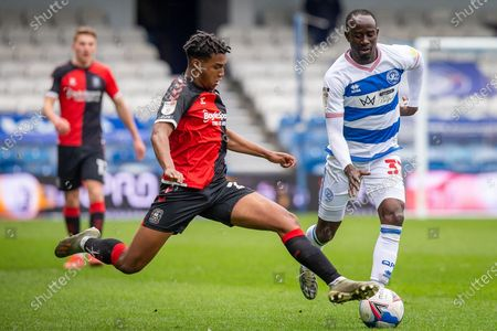 Coventry City defender Sam McCallum (21) tackles Queens Park Rangers midfielder Albert Adomah (37) during the EFL Sky Bet Championship match between Queens Park Rangers and Coventry City at the Kiyan Prince Foundation Stadium, London