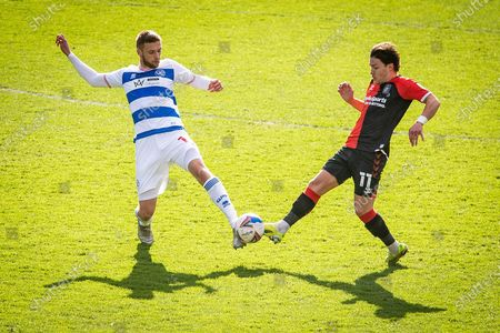 Queens Park Rangers midfielder Sam Field (15) battles with Coventry City midfielder Callum O'Hare (11) during the EFL Sky Bet Championship match between Queens Park Rangers and Coventry City at the Kiyan Prince Foundation Stadium, London