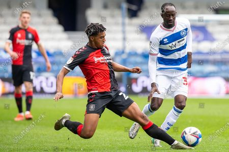 CORRECTION Coventry City defender Sam McCallum (21) tackles Queens Park Rangers midfielder Albert Adomah (37) during the EFL Sky Bet Championship match between Queens Park Rangers and Coventry City at the Kiyan Prince Foundation Stadium, London