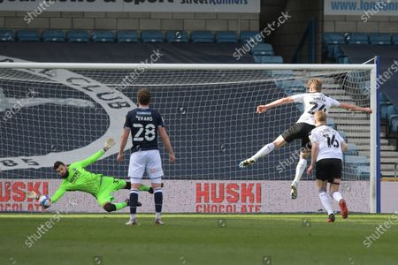 Penalty save by Bartosz Bialkowski of Millwall from Michael Smith of Rotherham United during the Millwall vs Rotherham United, EFL Championship Football match at the New Den London held behind closed doors.