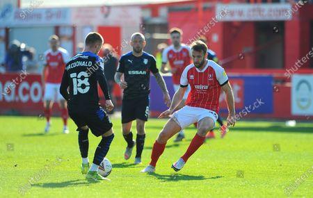 Calum MacDonald of Tranmere Rovers tries to get past Andy Williams of Cheltenham Town- Mandatory by-line: Nizaam Jones/JMP