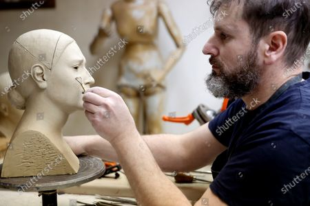 Sculptor Antonio Jose Martinez, who creates religious icons and statues, works in his workshop in Madrid, Spain, 31 March 2021 (issued 02 April 2021). For the second consecutive year in a row, Spain will have a Holy Week without processions due to the coronavirus COVID-19 pandemic. This year, however, the churches will remain open and religious rites can be attended, with faithful having to observe social distancing.