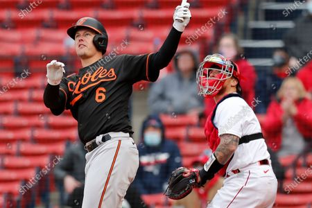 Baltimore Orioles' Ryan Mountcastle (6) follows through on his two-run double in front of Boston Red Sox's Christian Vazquez during the sixth inning of an opening day baseball game, in Boston