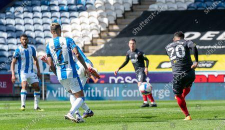Saman Ghoddos of Brentford volleys wide past Juninho Bacuna of Huddersfield Town; The John Smiths Stadium, Huddersfield, Yorkshire, England; English Football League Championship Football, Huddersfield Town versus Brentford.