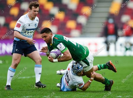 Stock Image of Curtis Rona of London Irish is tackled to ground by Matthew Morgan of Cardiff Blues