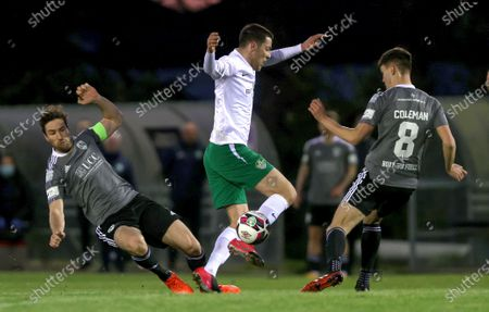 Stock Picture of Cabinteely vs Cork City. Cabinteely's Alex Aspil is tackled by Gearoid Morrissey and Cian Coleman of Cork City