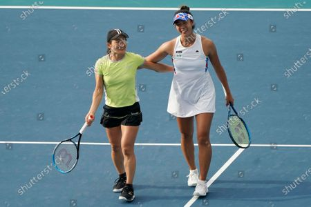 Shuko Aoyama, left, and Ena Shibahara, from Japan, smile after defeating Bethanie Mattek-Sands, of the United States, and Iga Swiatek, of Poland, during the women's doubles semifinals in the Miami Open tennis tournament, in Miami Gardens, Fla