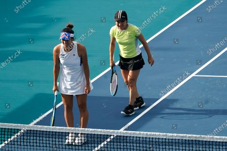 Ena Shibahara, of Japan, left, and Shuko Aoyama, right, also of Japan, bow after defeating Bethanie Mattek-Sands, of the United States, and Iga Swiatek, of Poland, during the women's doubles semifinals in the Miami Open tennis tournament, in Miami Gardens, Fla