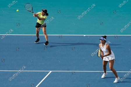 Shuko Aoyama, left, of Japan, and Ena Shibahara, right, also of Japan, right, play against Bethanie Mattek-Sands, of the United States, and Iga Swiatek, of Poland, during the women's doubles semifinals of the Miami Open tennis tournament, in Miami Gardens, Fla