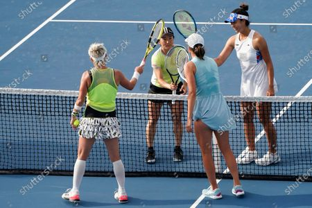 Shuko Aoyama, left, and Ena Shibahara, right, of Japan, meet Bethanie Mattek-Sands, front left, of the United States, and Iga Swiatek, of Poland, front right, after winning the women's doubles semifinals in the Miami Open tennis tournament, in Miami Gardens, Fla