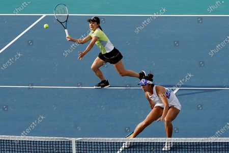 Shuko Aoyama, left, of Japan, and Ena Shibahara, right, also of Japan, play against Bethanie Mattek-Sands, of the United States, and Iga Swiatek, of Poland, during the women's doubles semifinals of the Miami Open tennis tournament, in Miami Gardens, Fla