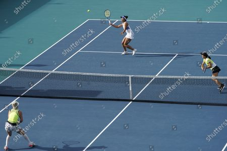 Ena Shibahara, back left, and Shuko Aoyama, right, of Japan, play against Bethanie Mattek-Sands, front left, of the United States, and Iga Swiatek, of Poland, during the women's doubles semifinals of the Miami Open tennis tournament, in Miami Gardens, Fla