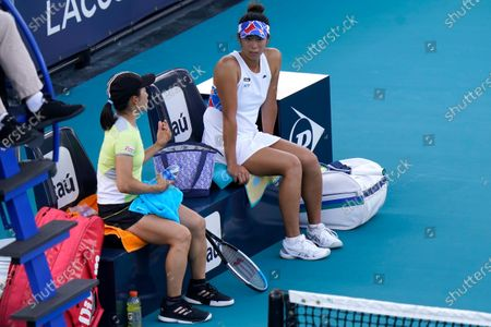 Shuko Aoyama, left, and Ena Shibahara, both of Japan, talk during a changeover in their match against Bethanie Mattek-Sands, of the United States, and Iga Swiatek, of Poland, during the women's doubles semifinals of the Miami Open tennis tournament, in Miami Gardens, Fla