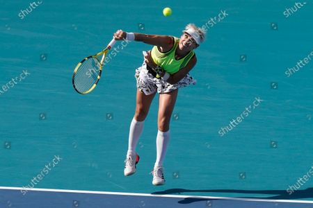 Stock Image of Bethanie Mattek-Sands, of the United States, serves during her women's doubles semifinals match with Iga Swiatek, of Poland, against Shuko Aoyama and Ena Shibahara, both of Japan, at the Miami Open tennis tournament, in Miami Gardens, Fla