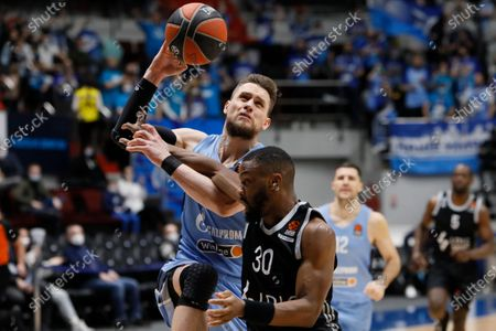 Stock Photo of Mateusz Ponitka (L) of Zenit St Petersburg and Norris Cole of LDLC ASVEL Villeurbanne in action during the EuroLeague Basketball match between Zenit St. Petersburg and LDLC ASVEL Villeurbanne on April 2, 2021 at Sibur Arena in Saint Petersburg, Russia.