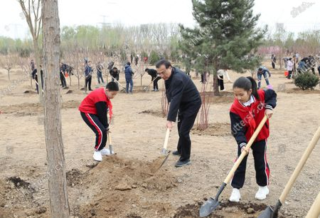 Editorial photo of China Beijing Leaders Tree Planting - 02 Apr 2021