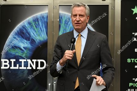 Mayor Bill de Blasio tours the exhibition opening of 'Blindness' at the Daryl Roth Theatre.