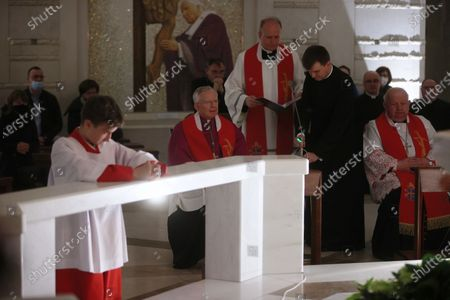 Archbishop of Krakow Marek Jedraszewski (2L) and cardinal Stanislaw Dziwisz (R) during the evening prayer at the Shrine of St. John Paul II in Krakow, Poland, 02 April 2021 on the 16th anniversary of the death of the Polish Pope.