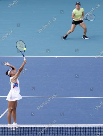 Shuko Aoyama (R) and Ena Shibahara (L) of Japan in action against Iga Swiatek of Poland and Bethanie Mattek-Sands of the USA during their semi-final Women's doubles match at the Miami Open tennis tournament in Miami Gardens, Florida, USA, 02 April 2021.