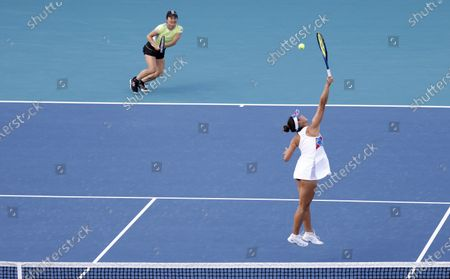Stock Picture of Shuko Aoyama (L) and Ena Shibahara (R) of Japan in action against Iga Swiatek of Poland and Bethanie Mattek-Sands of the USA during their semi-final Women's doubles match at the Miami Open tennis tournament in Miami Gardens, Florida, USA, 02 April 2021.